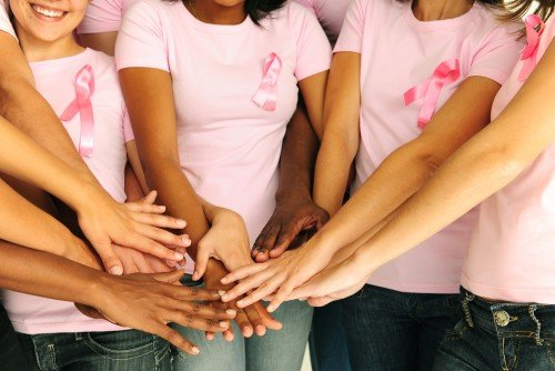 breast cancer group with pink shirts and ribbons