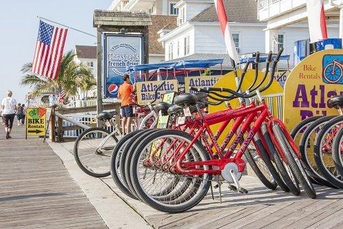 bike flag usa boardwalk beach people