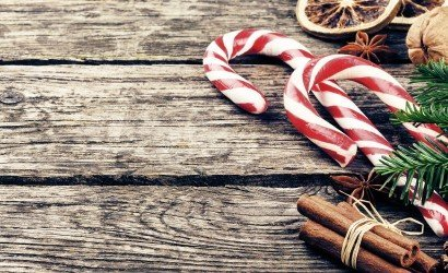 candy canes on worn wood_213161152