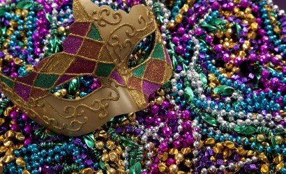 mardigras mask sitting on bed of beads
