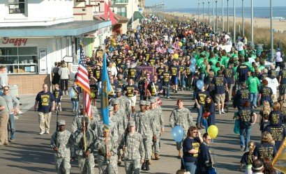 Boardwalk Buddy Walk event in Rehoboth Beach with lots of people on boardwalk