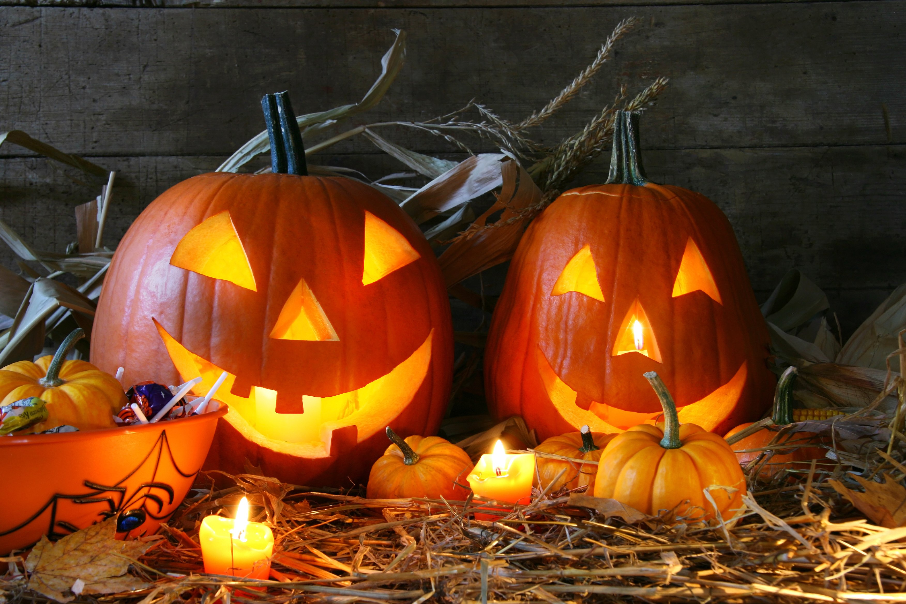 halloween jack o lanterns with candles and candy