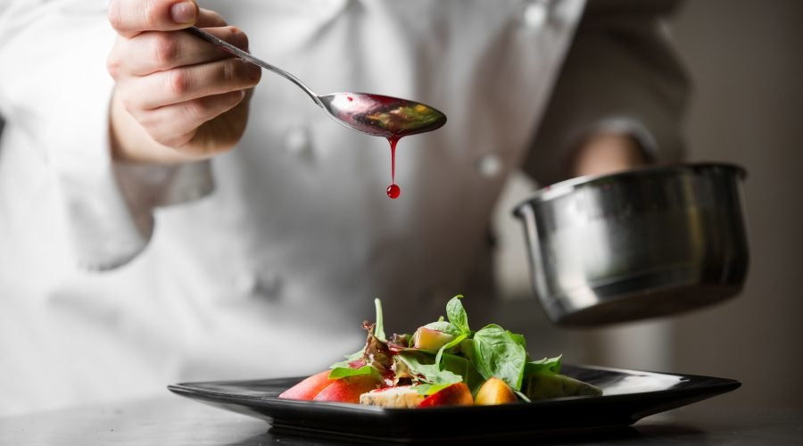 chef-dressing-a-plate_299406014