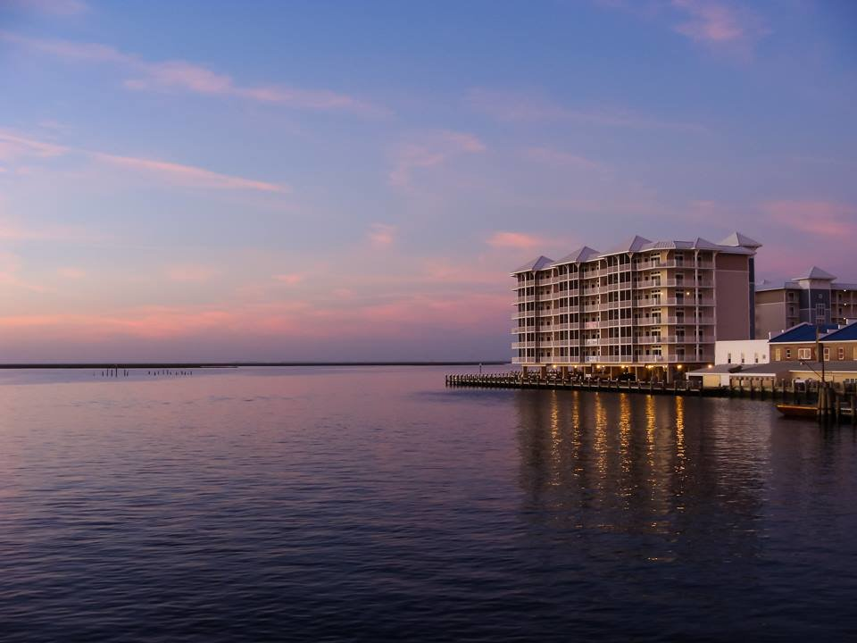 Condo building in Crisfield MD on the bay at sunset