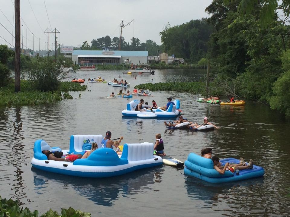 people floating on tubes in river during nanticoke riverfest