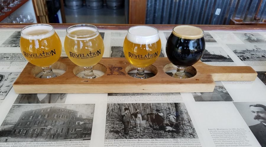Revelation is an Eastern Shore Brewery with a flight of four beers on the bar