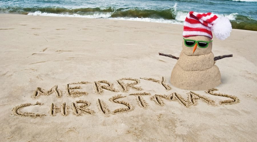 christmas in july events in ocean city with sand snowman with santa hat on the beach