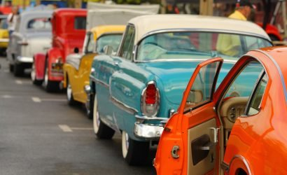 line of vintage cars on the street in ocean city at OC Cruzers event