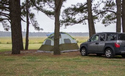 Chincoteague Island KOA one of several campgrounds on delmarva with tent and view of lighthouse