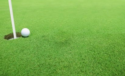 golf tournament with a golf ball on green grass