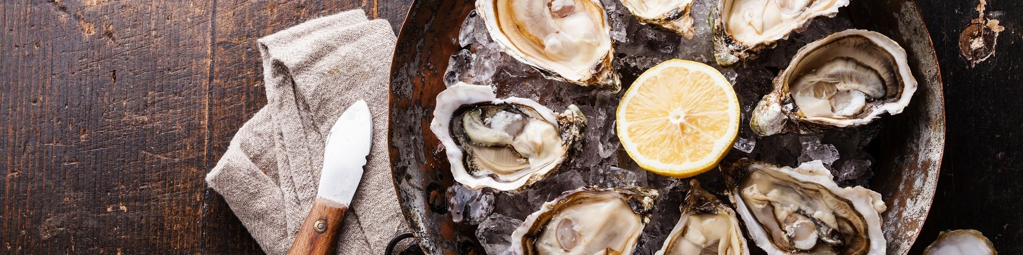 oysters on the half shell on a bed of ice for national oyster day