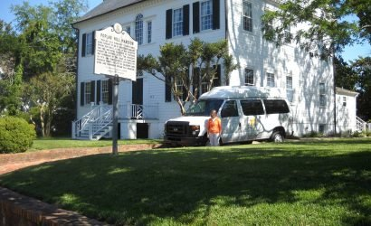 tour bus in front of Poplar Hill Mansion
