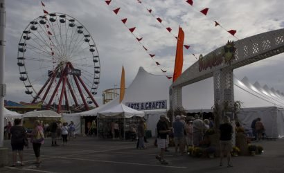 sunfest festival in ocean vity with arts and crafts tent and Ferris wheel