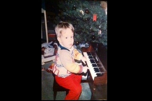 young child at a piano in front of a christmas tree for Brian's Christmas Songbook Concert