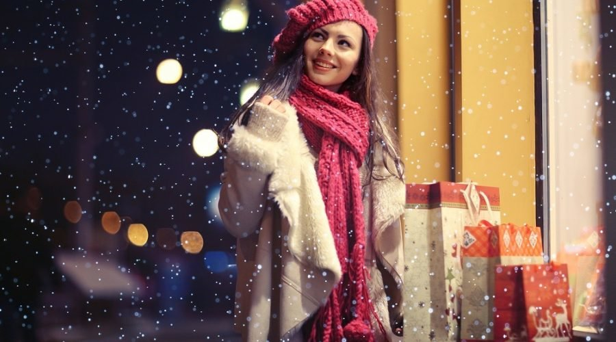 girl with shopping bags at christmas in the snow during a block party in ocean city