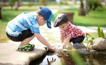 Two Boys Playing By Water