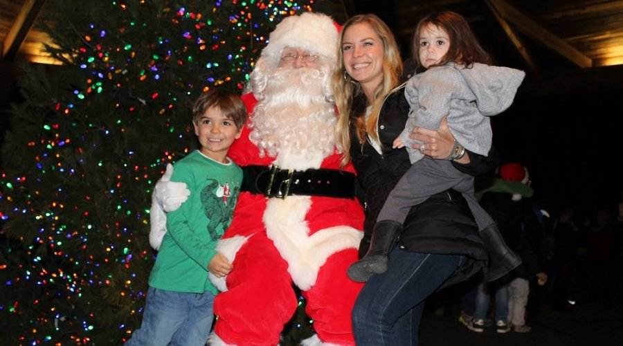 Santa Clause with two children and mom