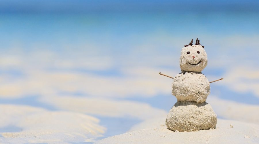 snowman made of sand on the beach