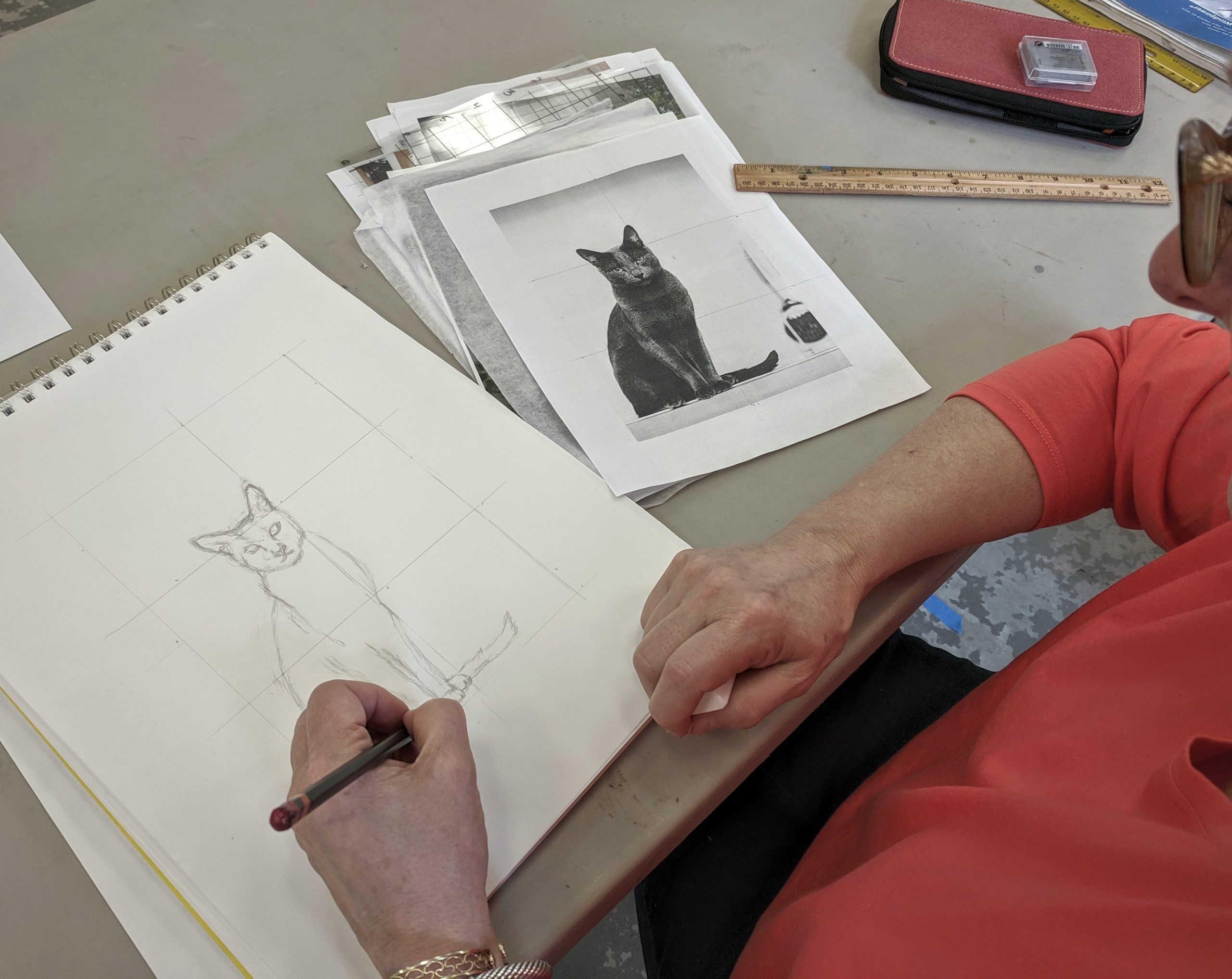 woman drawing a cat